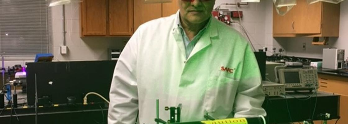 Dr. Aristides Marcano working in the Laboratory of Quantum Optics at Delaware State University.